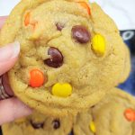 hand holding reeces pieces cookie